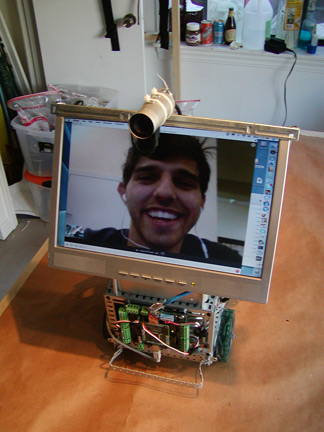Programer John Celenza performs as Sparky, the web-enabled telepresence robot
